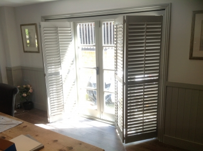 Track shutters for wide windows and doors